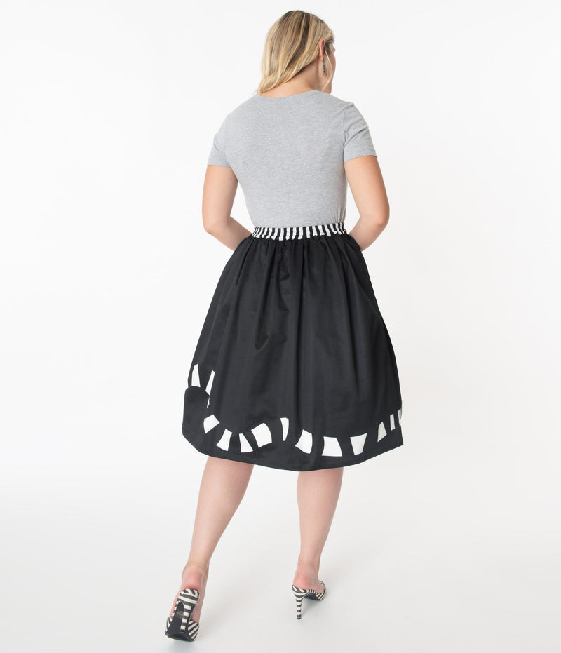 This is a Beetlejuice vintage pinup Sandworm swing skirt from Unique Vintage, that is black with a striped worm and the model is wearing a grey shirt and black and white striped shoes, with her hair to the side.