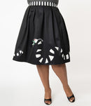 This is a Beetlejuice vintage pinup Sandworm swing skirt from Unique Vintage, that is black with a striped worm and the plus model is wearing black shoes.