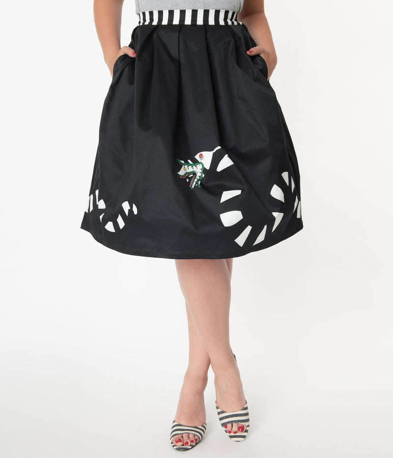 This is a Beetlejuice vintage pinup Sandworm swing skirt from Unique Vintage, that is black with a striped worm and the model is wearing a grey shirt and black and white striped shoes.