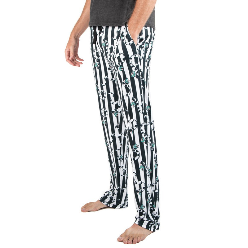 This is a Beetlejuice Sandworm sleep pant pajamas and they are black and white striped, with striped worms with green heads and it has pockets.