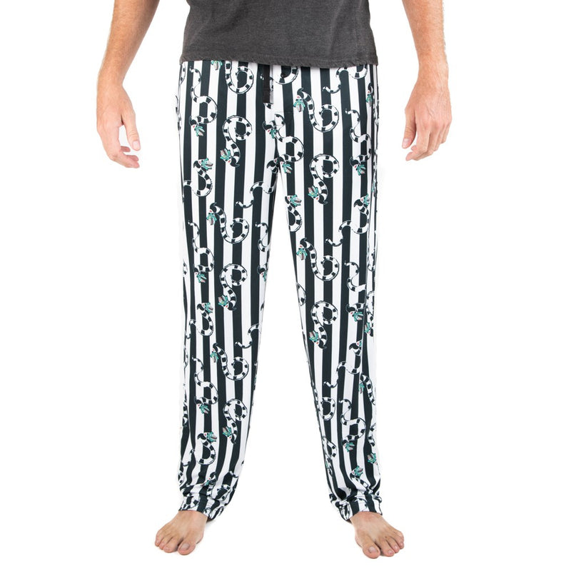 This is a Beetlejuice Sandworm sleep pant pajamas and they are black and white striped, with striped worms with green heads.