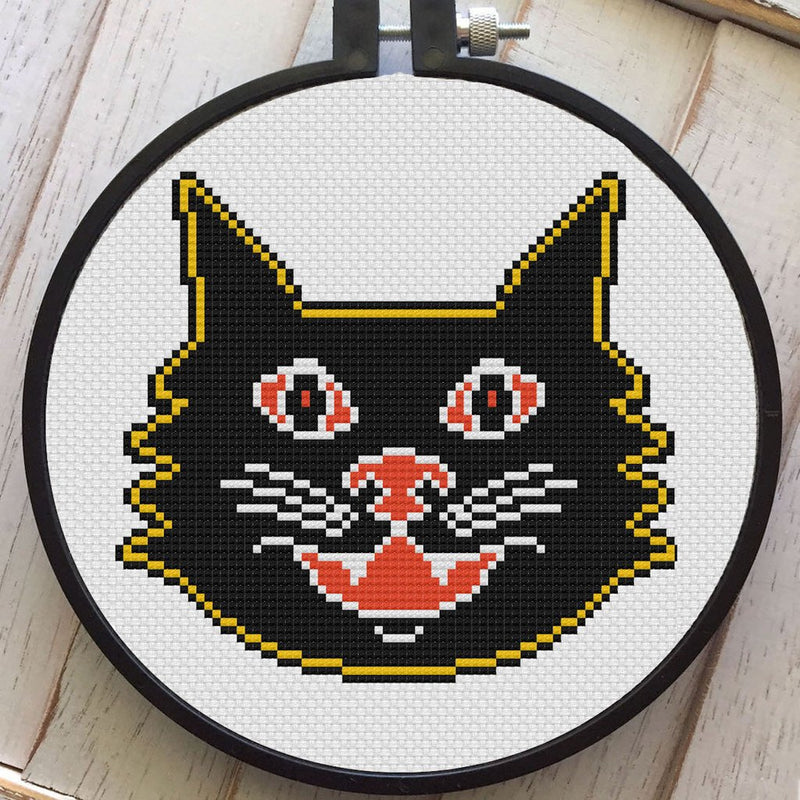 This is a DIY cross stitch kit and it is a vintage style black cat, with yellow and orange accent colors.