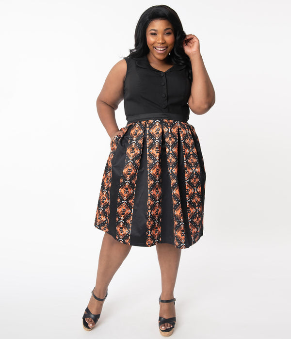 This is a Unique Vintage Halloween swing skirt that has black cats, bats and skulls with orange print and the model is wearing a plus sized black shirt.