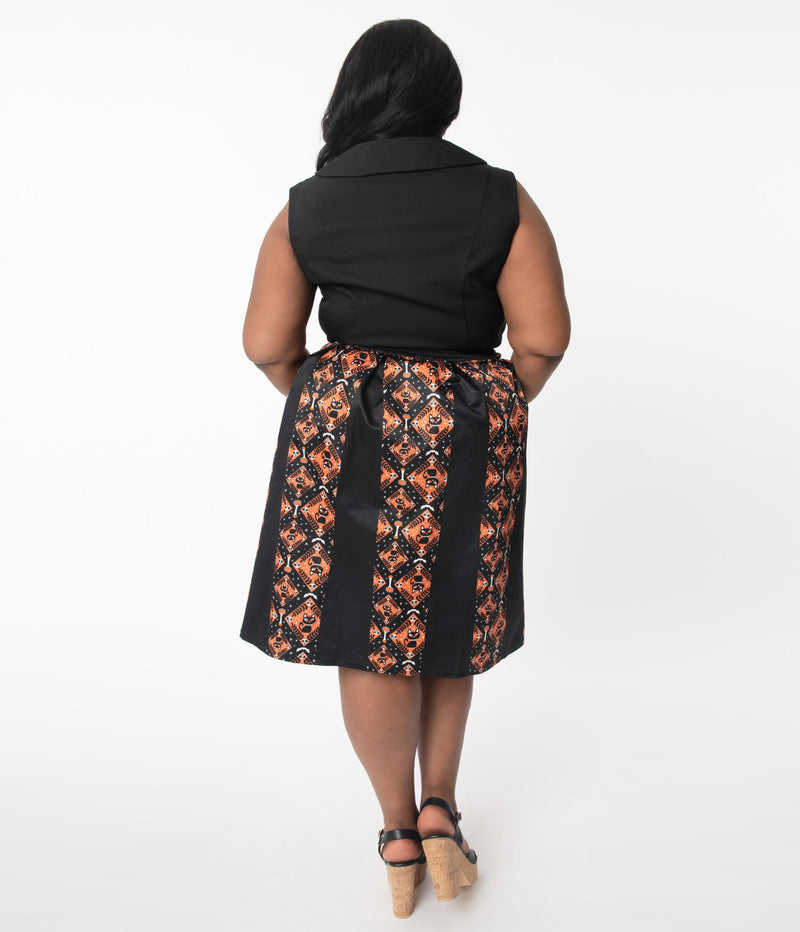 This is the back of a Unique Vintage Halloween swing skirt that has black cats, bats and skulls with orange print and the model is wearing a plus sized black shirt.