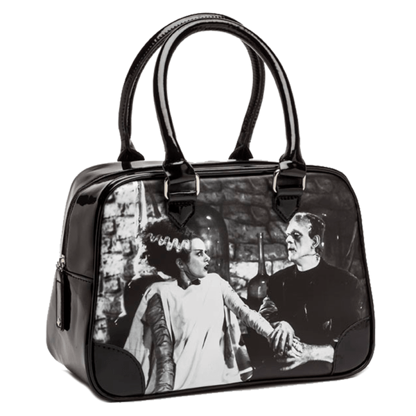This is a black and white universal monsters Bride of Frankenstein bowler handbag purse and has Frankenstein holding her hand.