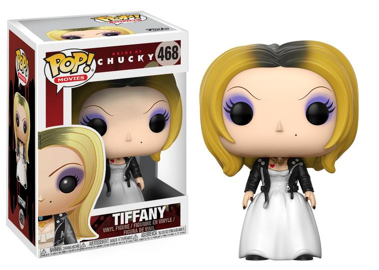 This is a Bride of Chucky Tiffany Pop Vinyl Funko and she is wearing a white dress, black leather jacket and shoes and she has blonde hair
