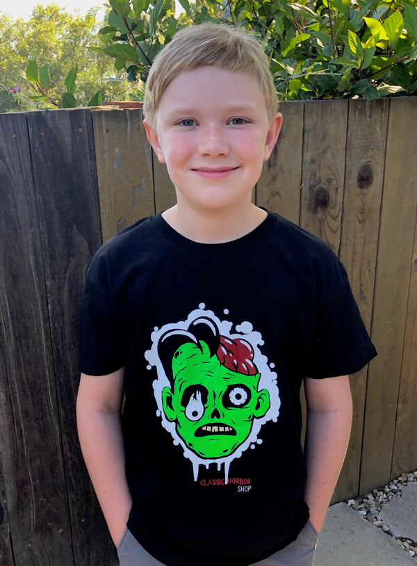 Kid facing forward wearing a black Classic Horror T-shirt