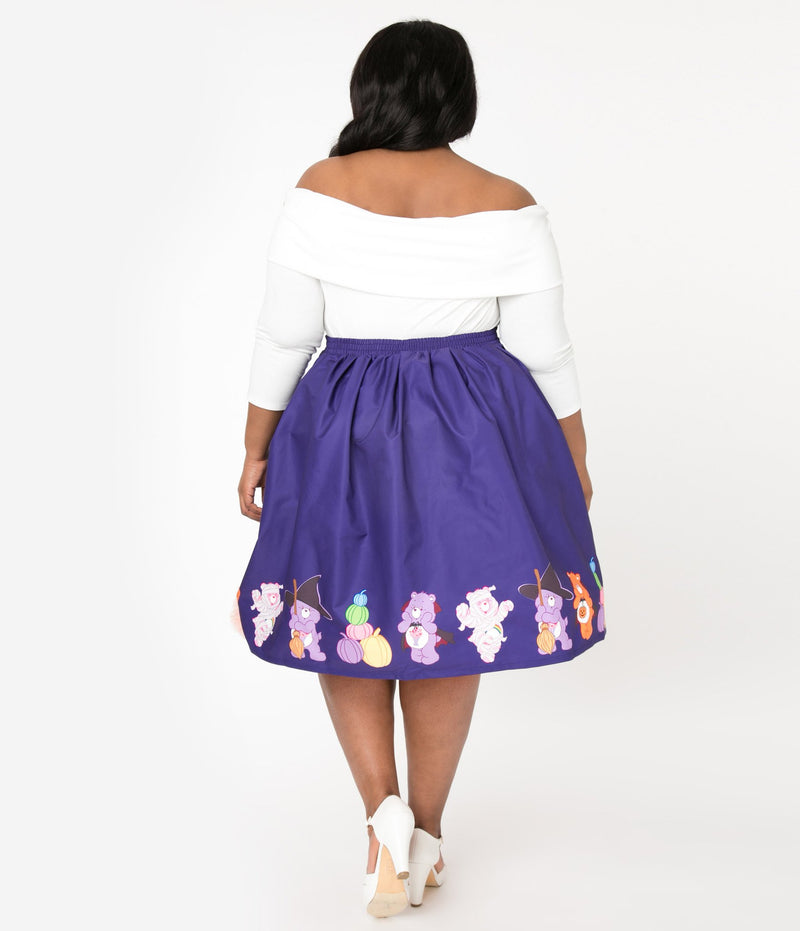 This is a Care Bears halloween purple Jayne swing skirt by Unique Vintage and the plus model is wearing a white shirt and has on white shoes and her dark hair is to the side.