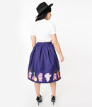 This is a Care Bears halloween purple Jayne swing skirt by Unique Vintage and the model is wearing a white shirt and has on black shoes and a black hat and her brown hair is to the side.