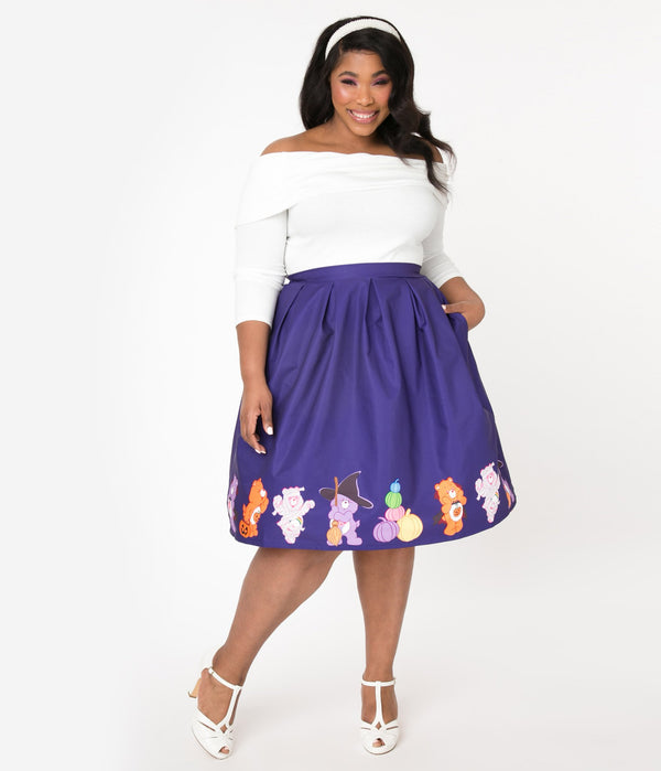 This is a Care Bears halloween purple Jayne swing skirt by Unique Vintage and the plus model is wearing a white shirt and has on white shoes.