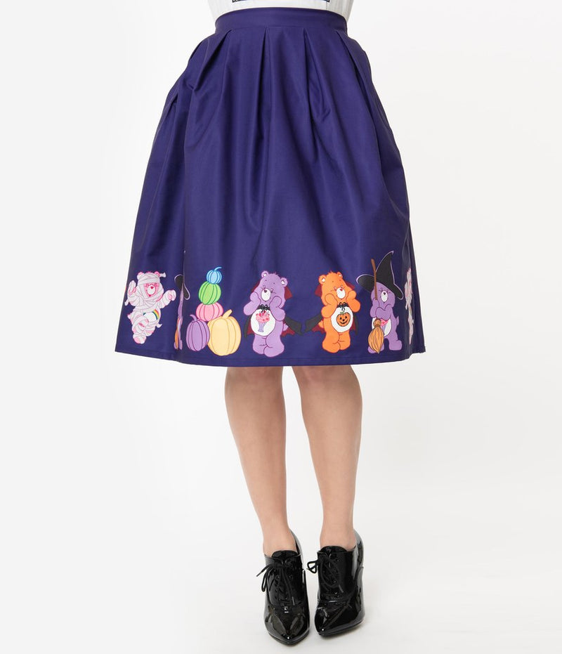 This is a Care Bears halloween purple Jayne swing skirt by Unique Vintage, with pumpkins, witch hats and brooms and the model has on black shoes.