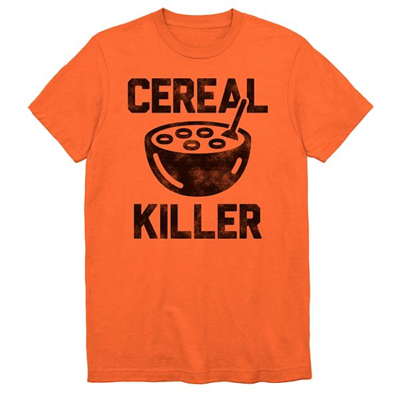 This is an orange t-shirt and it has black letters that say cereal killer and a bowl of cereal with a spoon in it.