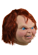 This mask is of Chucky from Child's Play 2 and he has bright blue eyes, orange hair and a butt chin and he is turned to the side.