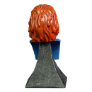 This is a Bride of Chucky mini bust and he has orange hair and is on a grey stand.