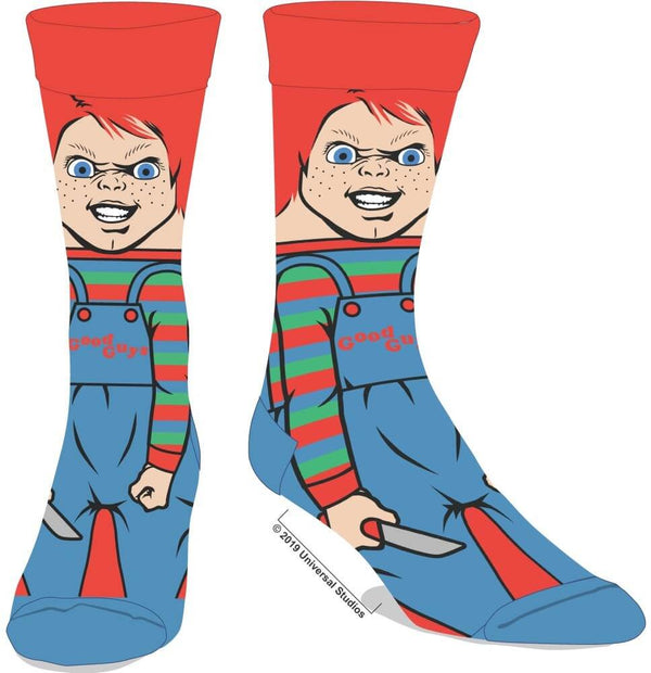These are crew socks that are printed with Chucky from Child's Play and he has orange hair and striped overalls and he is holding a knife.