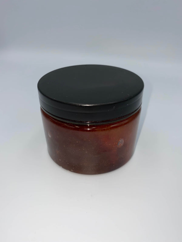 This is a red, blood like hemp sugar body scrub in a clear jar, with a black lid.