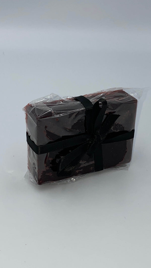 This is a dark blood red bath soap in plastic, with a black ribbon.