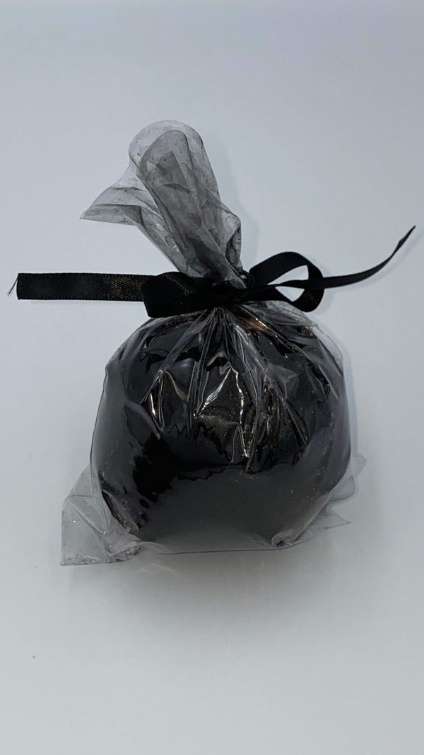 This is a black charcoal hemp bath bomb that is in plastic and closed with a black ribbon.