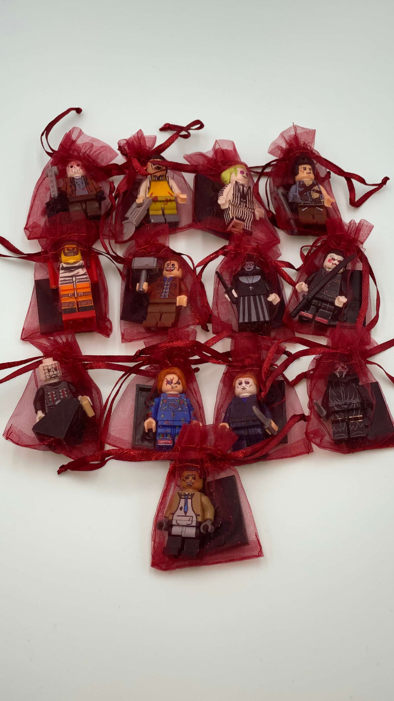 These are LEGO mini figures of horror characters: Leatherface, Jason Voorhees, Beetlejuice, Ash, Hannibal, Jack Torrance, Nun, Billy, Pinhead, Chucky, Michael Myers and Ghostface.