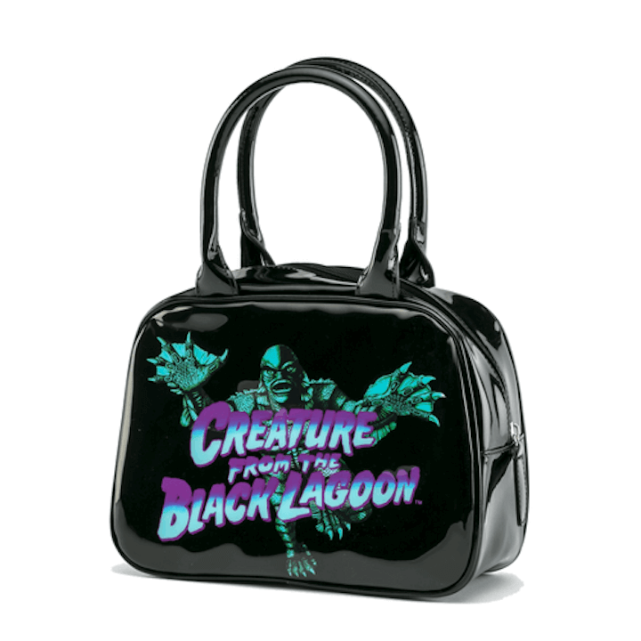 This is a universal monsters Creature From the Black Lagoon bowler handbag black purse that has blue and purple writing and a green monster.