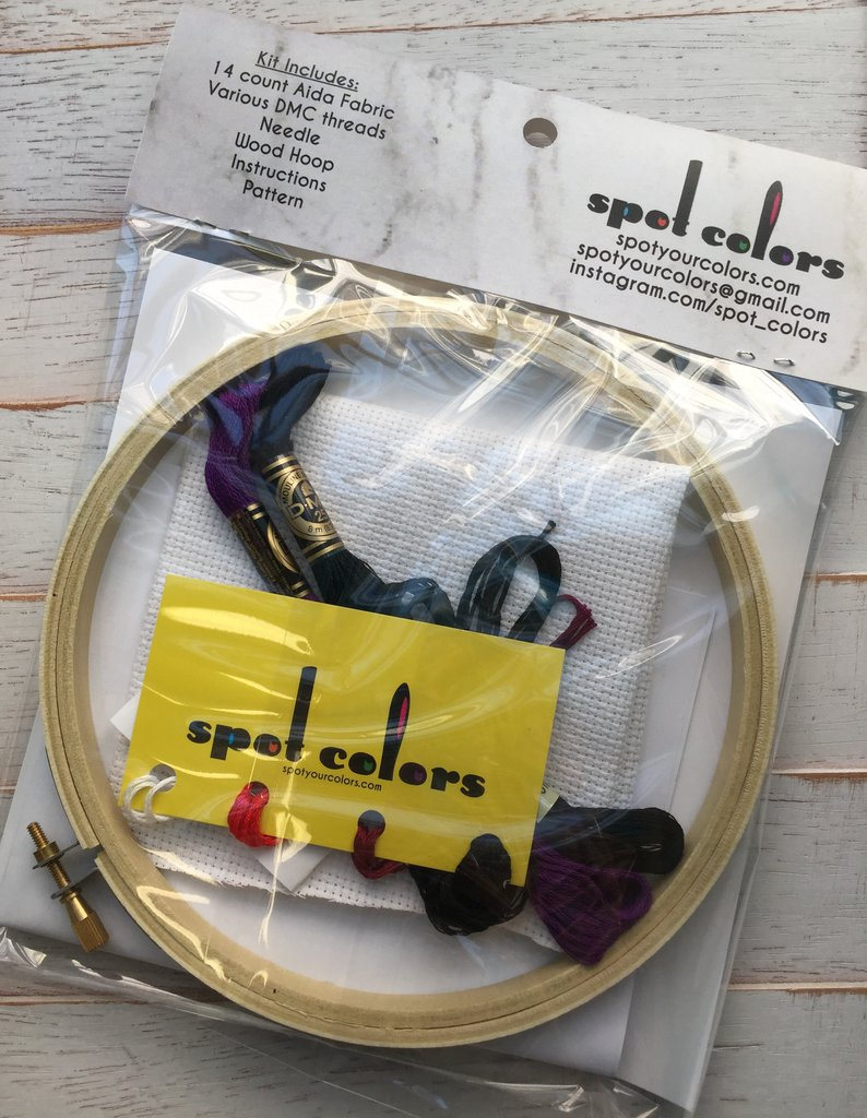 This is a cross stitch kit and includes wooden hoop, thread, pattern and material.