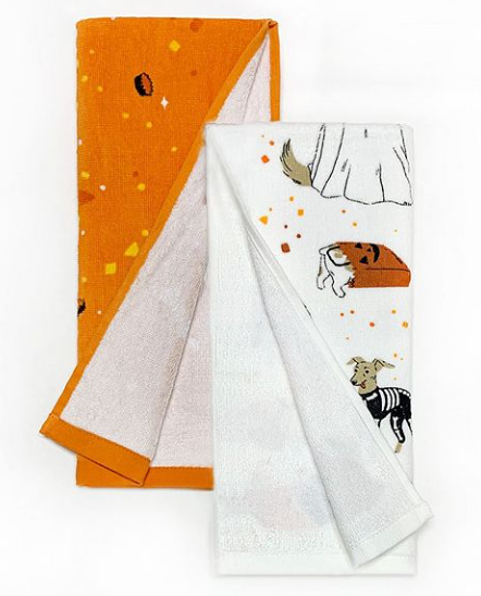 This is a set of 2 kitchen towels and one is orange and the other is white and has a chihuahua in a skeleton costume.