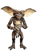 This is a Gremlins evil gremlin puppet prop, who is standing and he is green with big ears, spikes on his head and red eyes.