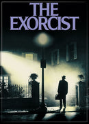 This is an Exorcist movie poster magnet that has a silhouette of a man with a hat and a lamp post, with an apartment building in the background.