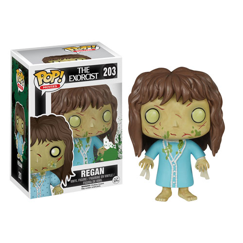 This is an Exorcist Regan Pop Funko and she has ties around her wrists, a blue nightgown, brown hair and vomit on her face.