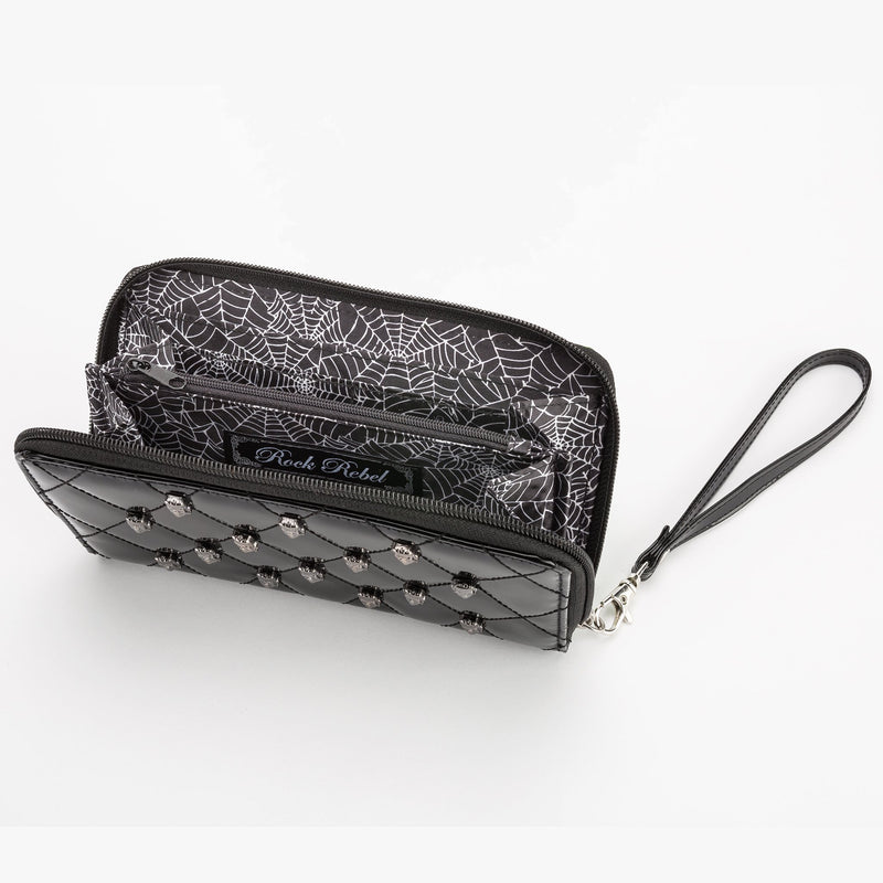 This is a vegan black Universal Monsters wallet that is shiny and has pockets inside.