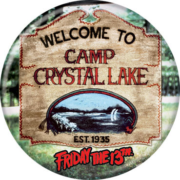 This is a Friday the 13th Camp Crystal Lake button and it is a brown welcome sign with the lake on it.