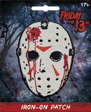 This is a Friday the 13th Jason Voorhees iron on patch that has a hockey mask with red triangles and blood on it.