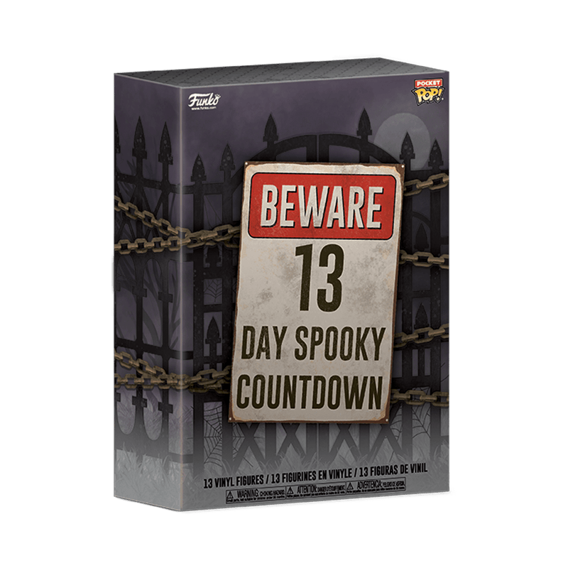 This is a Funko Pocket Pop 13 day spooky advent calendar and it has a purple cardboard box with a black fenced that has a chain around it and the front says beware in red and 13 day spooky countdown in black letters.