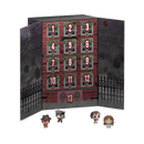 This is a Funko Pocket Pop 13 day spooky advent calendar and it has a cardboard box with a black gate, windows with numbers in them and Freddy, Beetlejuice, Regan and Jack Torrance in front.