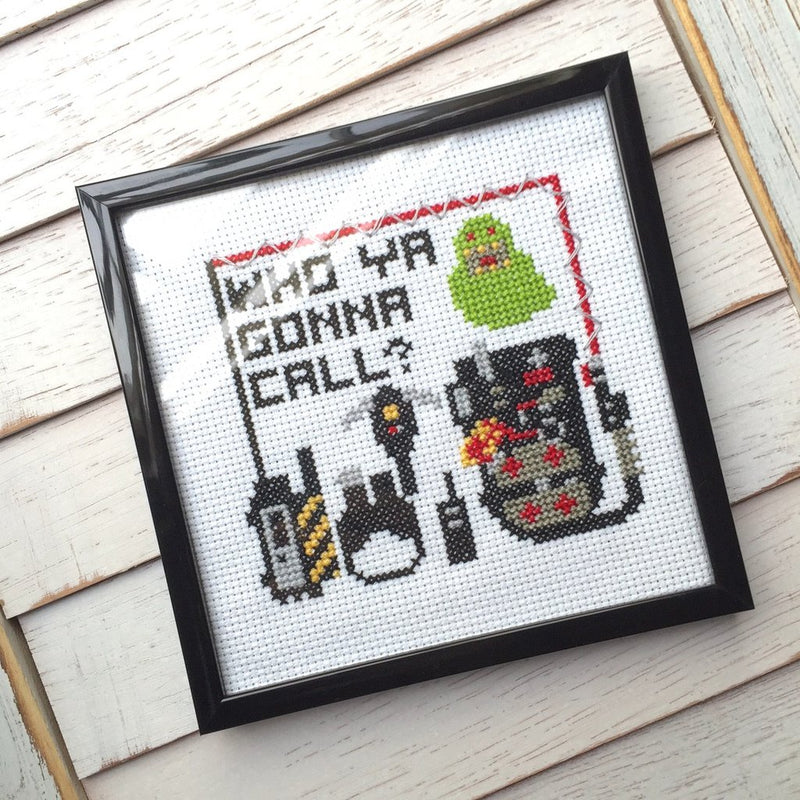 This is a Ghostbusters Slimer DIY cross stitch kit and he is green, there is a proton pack and ghost hunting tools.