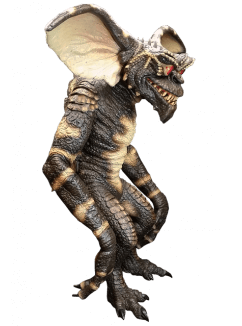 This is a Gremlins evil gremlin puppet prop, who is standing and he is green with big ears, spikes on his head, red eyes, sharp teeth and pointy feet.