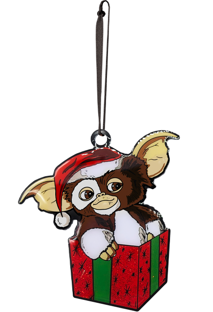 This is a Gizmo Gremlins ornament and he has brown and white fir with a red hat with a white ball, while sitting in a red box with green ribbon.
