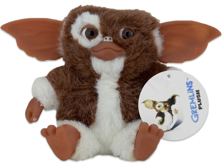 "This is a fuzzy NECA 6"" plush of Gremlins Gizmo and he is brown and white with tan, hard ears, hands, feet and nose."