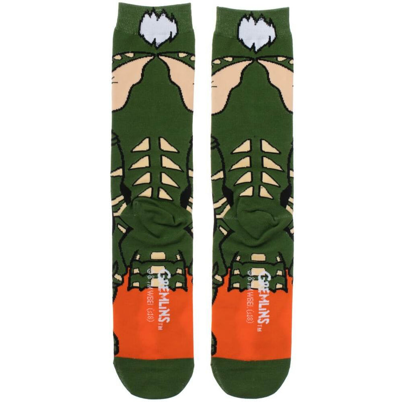 This is a pair of Gremlins Spike 360 printed socks and he is green with white spikey hair and spikes on his back.