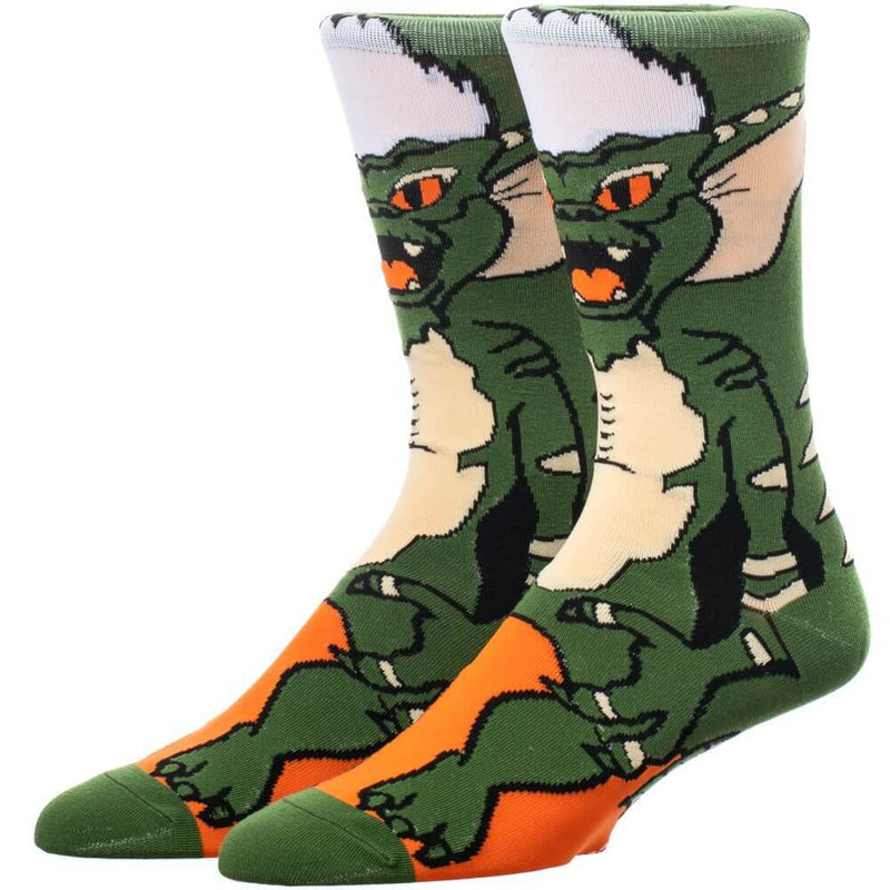 This is a pair of Gremlins Spike 360 printed socks and he is green with white spikey hair.