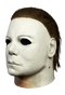 This is a Halloween 1978 Boogeyman Michael Myers Mask that is a white face, white ear, with brown hair and tan neck.