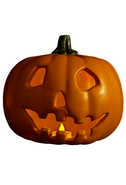 This is a Halloween 1978 pumpkin prop that is orange with a green stem and the pumpkin is smiling and has a light in it.