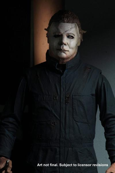 This is a Halloween II Michael Myers NECA action figure and he is wearing a white mask with green blue coveralls..