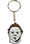 This is a Halloween II Michael Myers enamel Keychain that has a white face, brown hair and a silver chain with a hoop for keys.