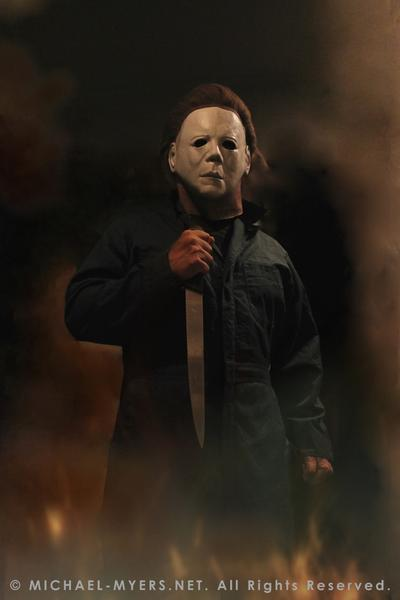 This is a Halloween II Michael Myers mask, that is a white face with brown hair and eye holes, a knife and green coveralls.