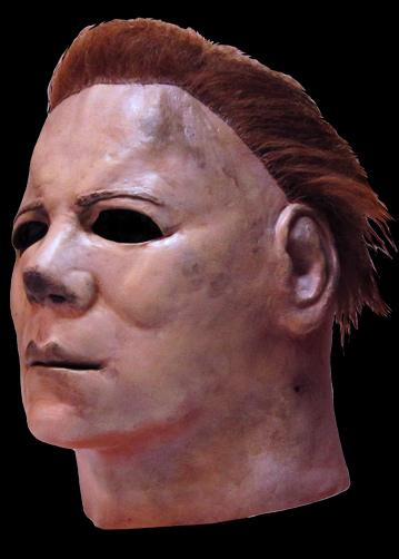 This is a Halloween II Michael Myers mask, that is a white face with brown hair and eye holes.