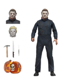 This is a Halloween II 1981 Michael Myers NECA action figure and includes 3 head with Ben Tramer, a hammer, knife syringe and has a pumpkin that opens.