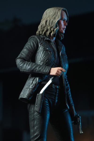 "This is a HALLOWEEN 2018 NECA 7"" Scale Action Figure Ultimate Laurie Strode and she has grey hair, glasses, a coat and a knife"