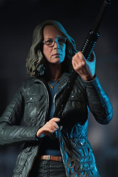 "This is a HALLOWEEN 2018 NECA 7"" Scale Action Figure Ultimate Laurie Strode and she has grey hair, glasses, a coat and is holding up a rifle."