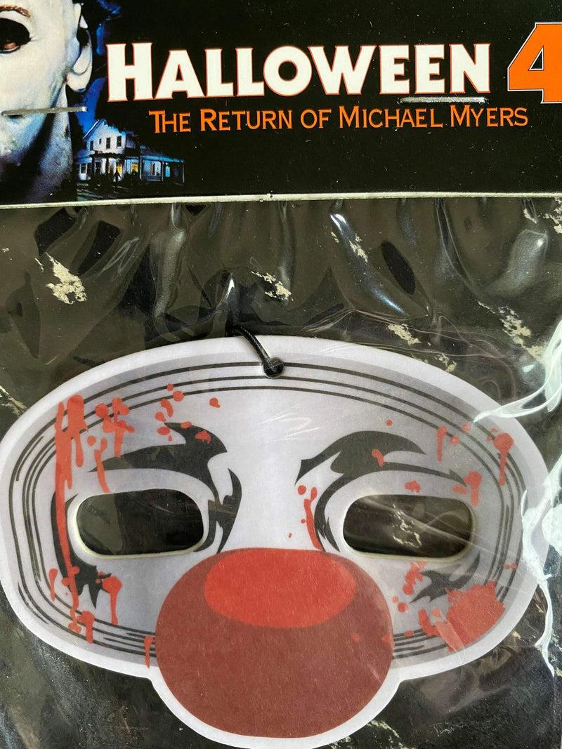 This is a Halloween 4 Return of Michael Myers air freshener that is a grey and silver mask with a red ball nose.